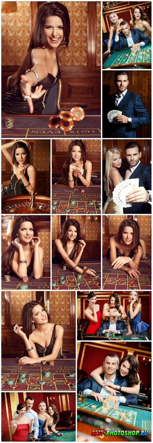 Gambling people in casino stock photo