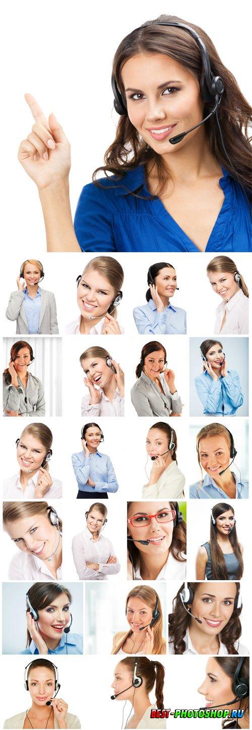 Charming female operators in headphones stock photo
