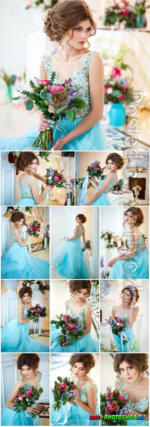 Girl in blue evening dress with flowers stock photo