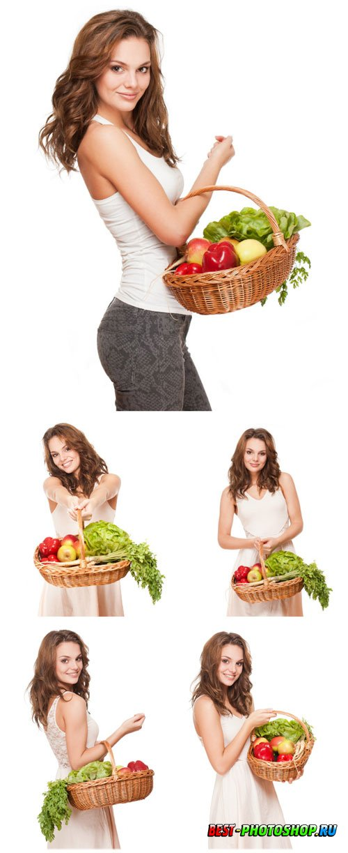 Girl holding a basket of vegetables stock photo