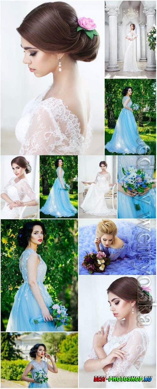 Lovely brides in luxury wedding dresses stock photo